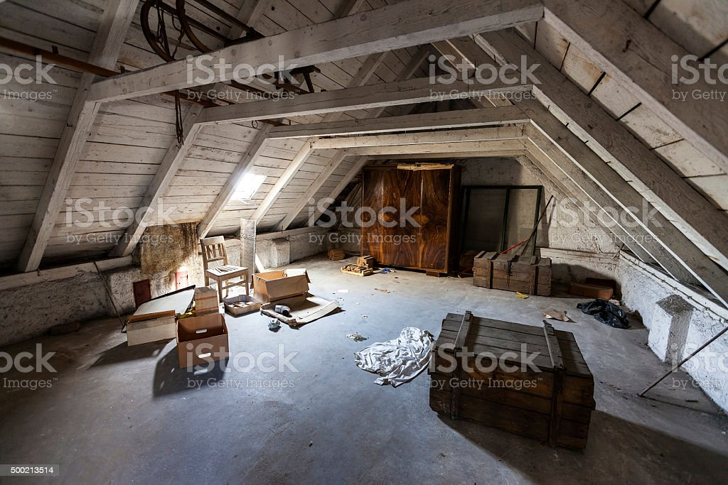 Old attic with hidden secrets of an abandoned house stock photo