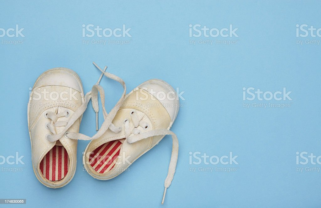 Old Baby Shoes On Blue royalty-free stock photo