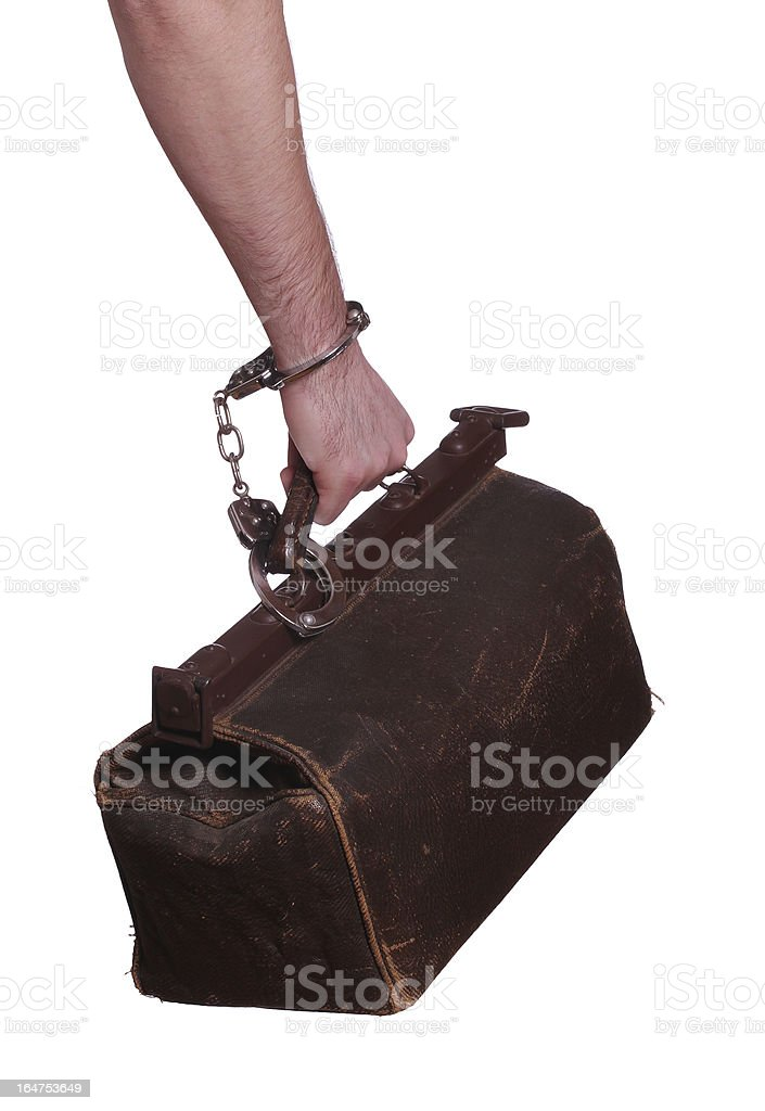 old bag protected with handcuff royalty-free stock photo