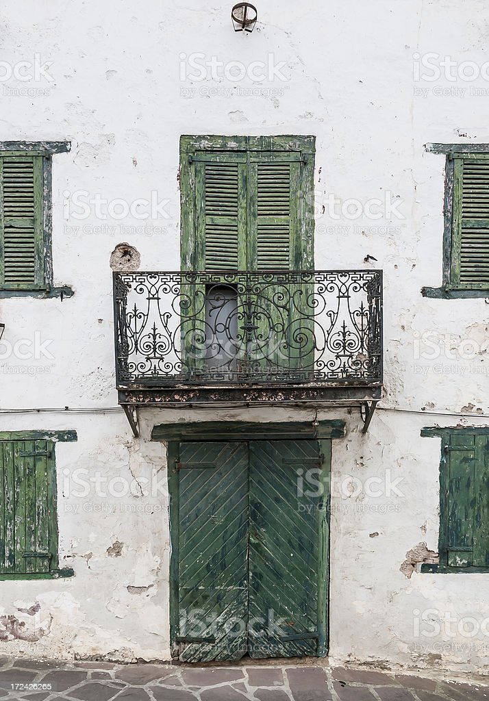 Old balcony and closed shutters royalty-free stock photo