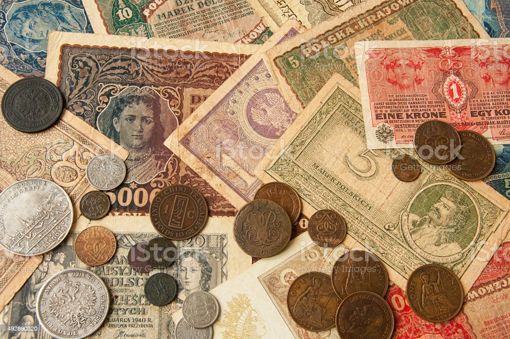 old banknotes with antic silver and copper coinsvintage background stock photo