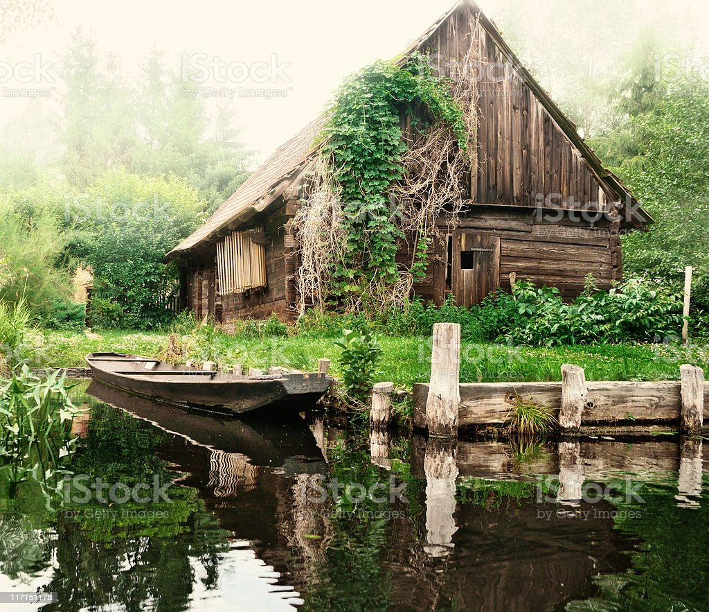 Old barn and boat in Spreewald /Germany royalty-free stock photo