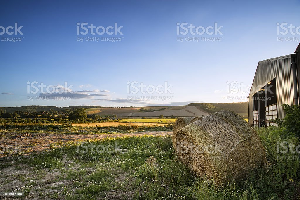 Old barn and hay bales in Summer countryside landscape royalty-free stock photo