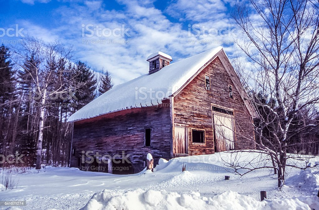 Old Barn in Maine in winter stock photo