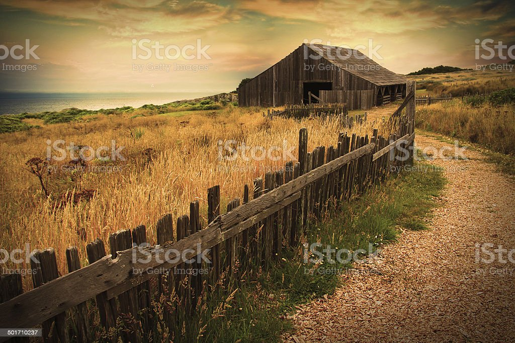 Old Barn Overlooking Sea stock photo