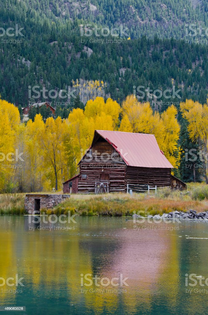 Old Barn Reflected in Autumn stock photo