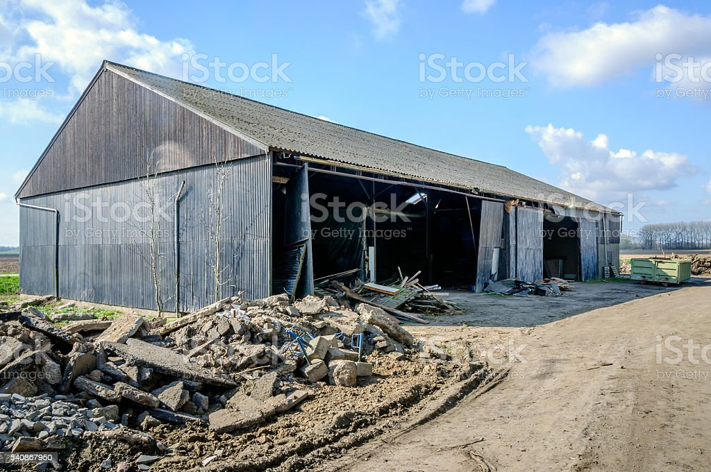 Old barn shortly before the demolition stock photo