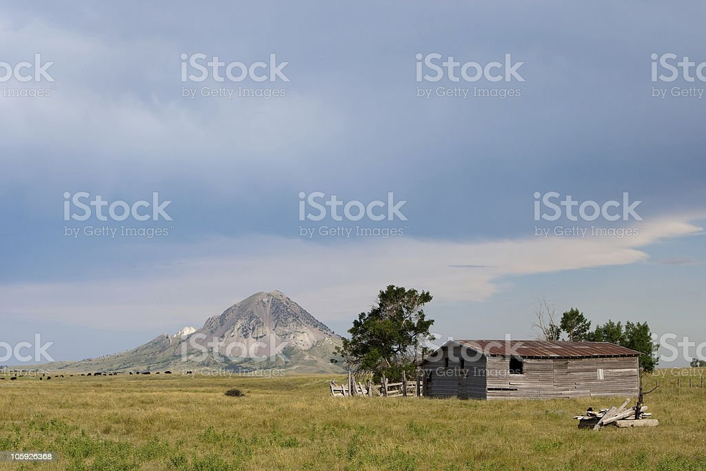 Old Barn with Butte in Background stock photo