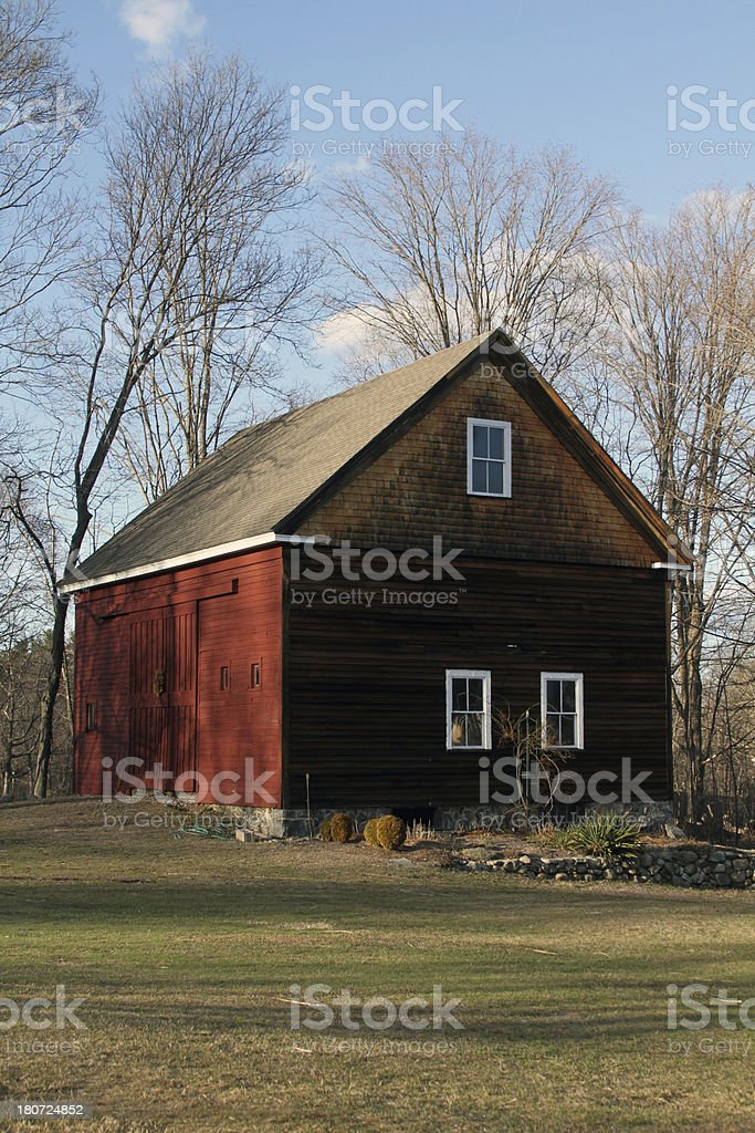 old barn with grass in foreground stock photo