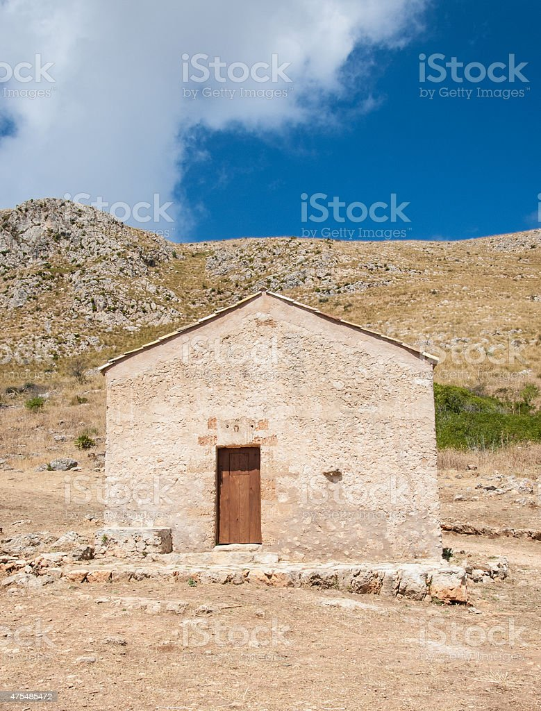 Old barn with no windows in the countryside. stock photo