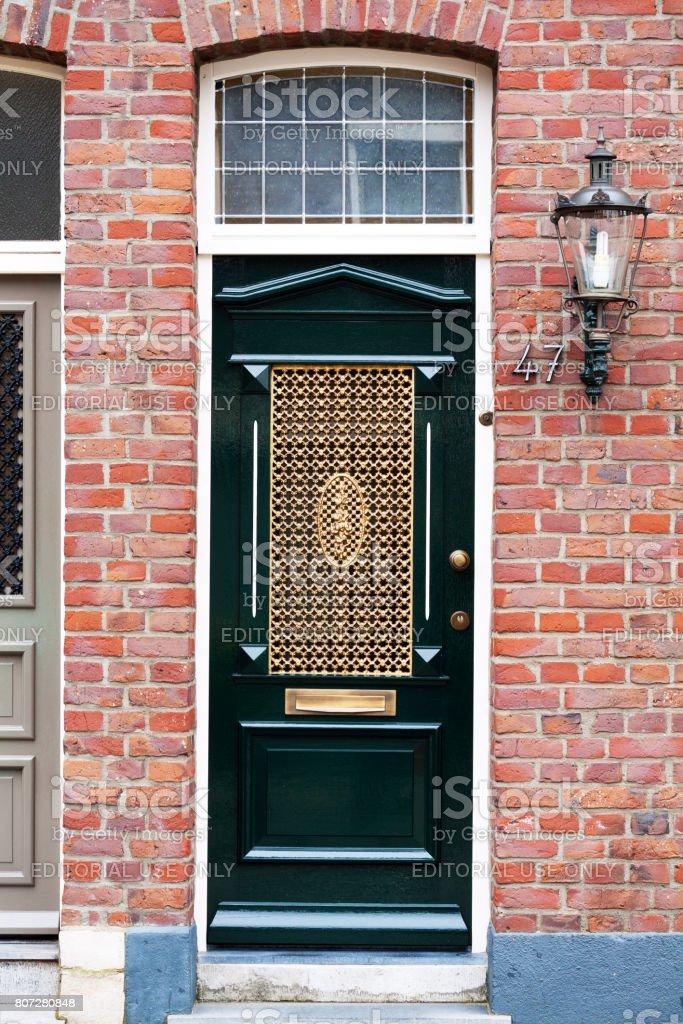 Old baroque door in Venlo stock photo