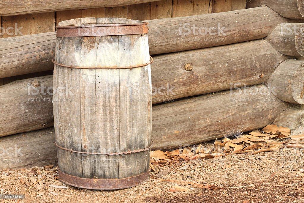 Old Barrel Against Side Of Log Cabin stock photo