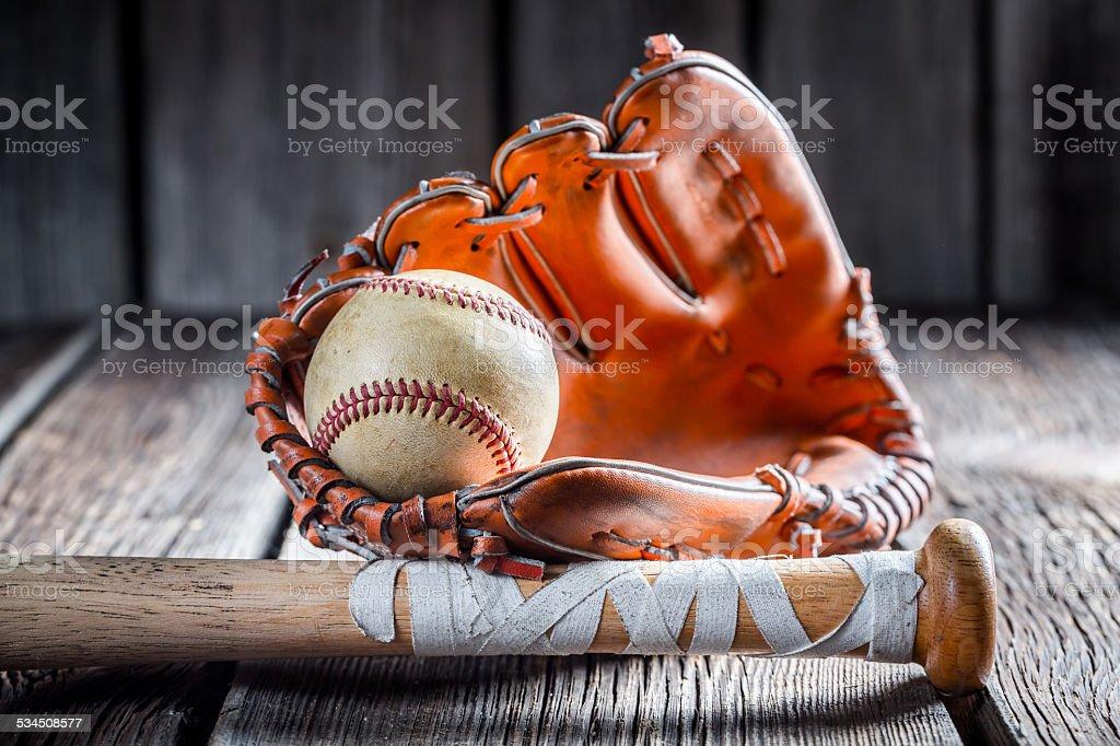 Old baseball ball and stick stock photo