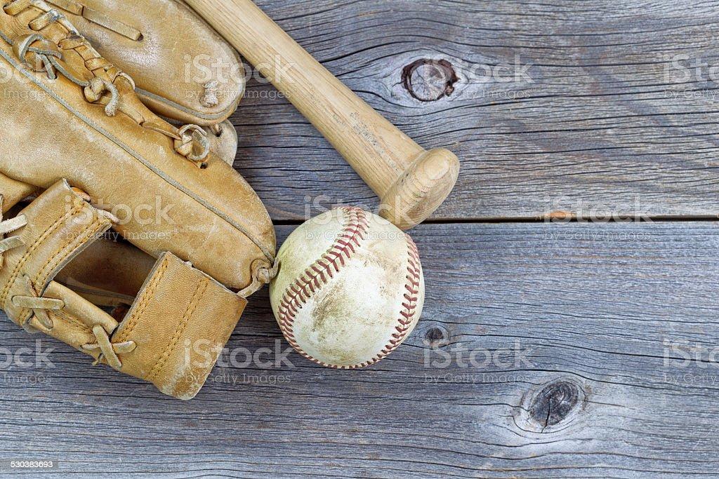 Old Baseball equipment on Aged Wood stock photo