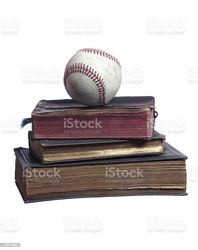 old baseball on books stock photo