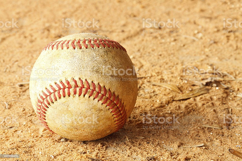 Old Baseball On Infield Dirt stock photo