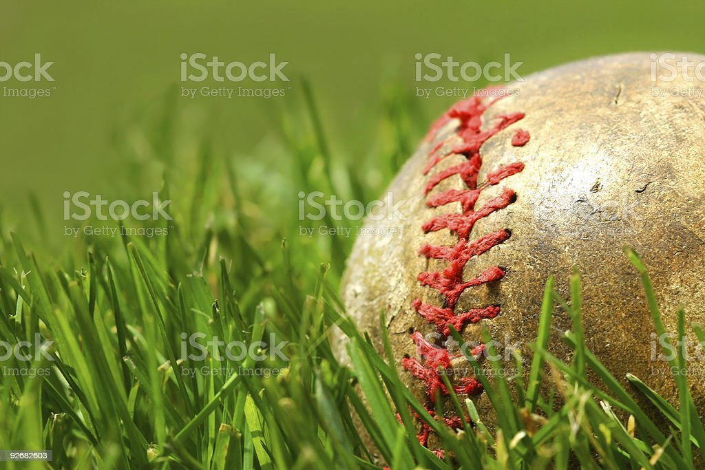 Old baseball on the grass royalty-free stock photo