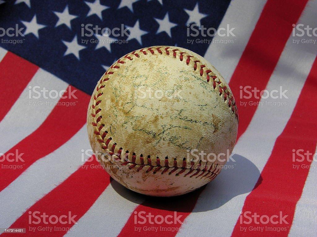 Old baseball on USA flag. stock photo
