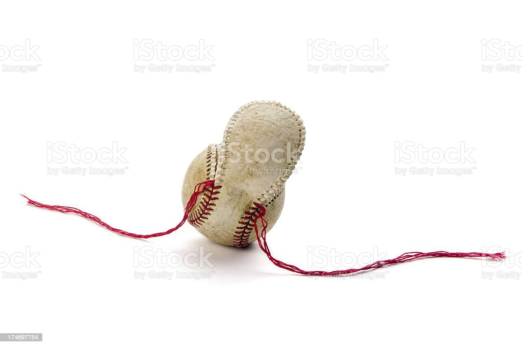Old baseball with unstitched seams and loose cover royalty-free stock photo