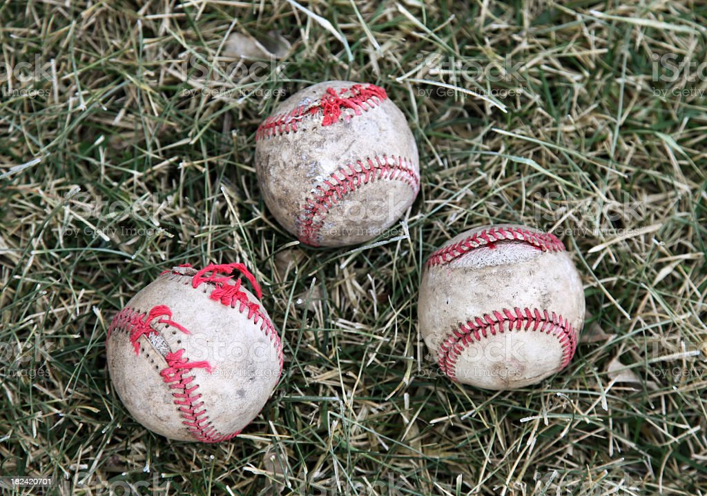 Old baseballs on grass royalty-free stock photo