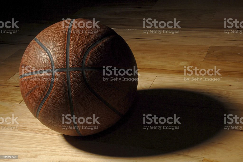 Old Basketball in an Empty Gym royalty-free stock photo