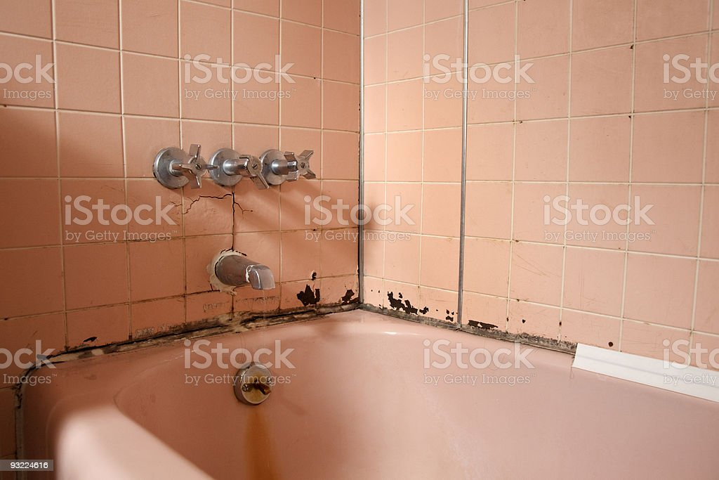 Old bath in need of repair stock photo