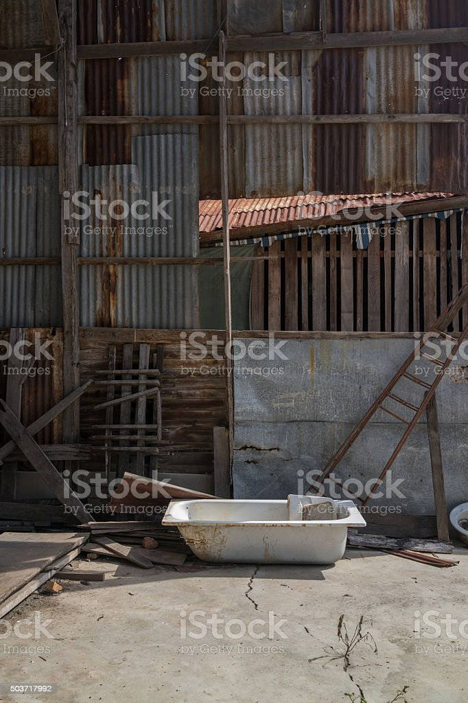 Old bathtub in abandoned house stock photo