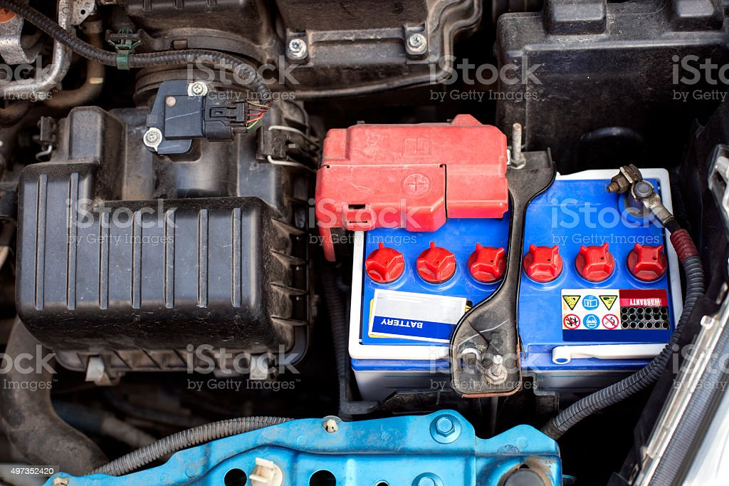 Old Battery in old car . stock photo