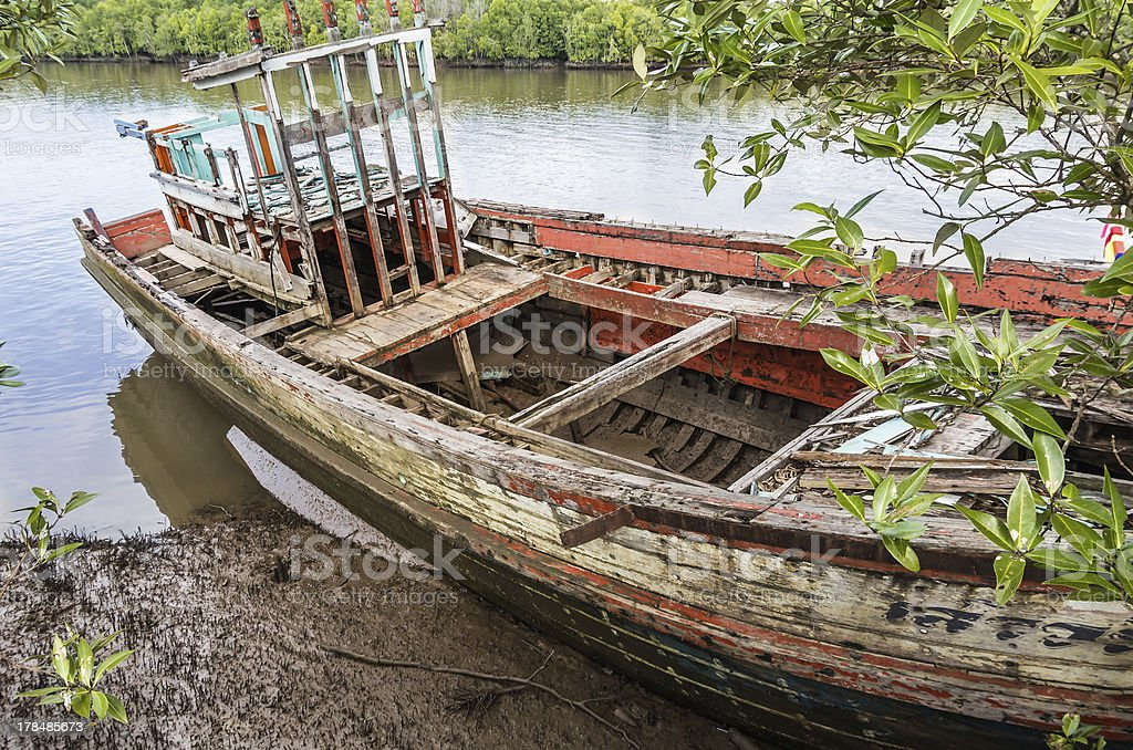 Old beached fishing Boat - Krabi River, Thailand royalty-free stock photo
