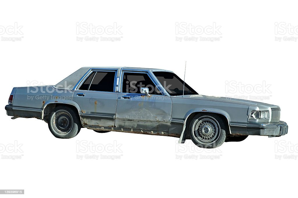 Old beat up Ford Crown Victoria from the early 1990's stock photo