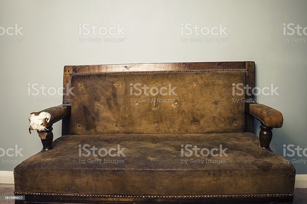Old beaten up sofa royalty-free stock photo