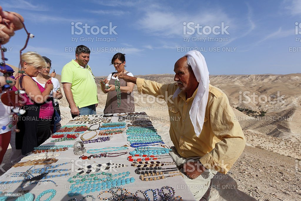Old Bedouin Selling Souvenirs stock photo