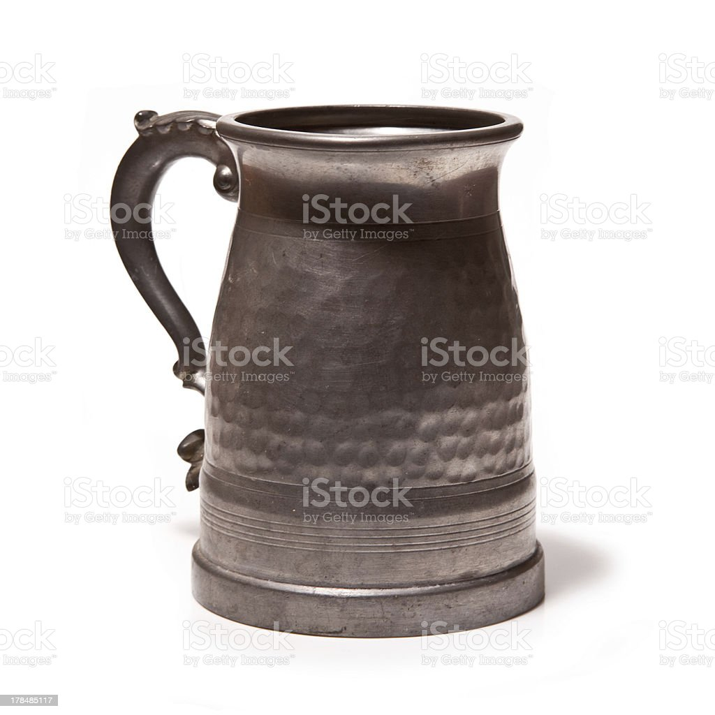 Old beer tankard on a white background. stock photo