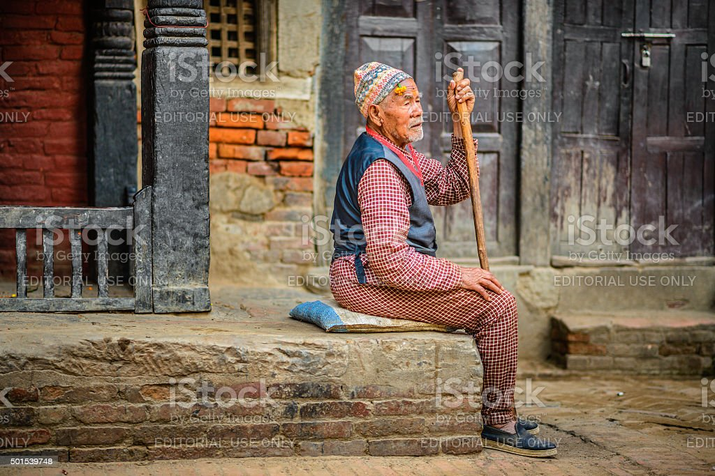 Old beggar with a walking stick stock photo