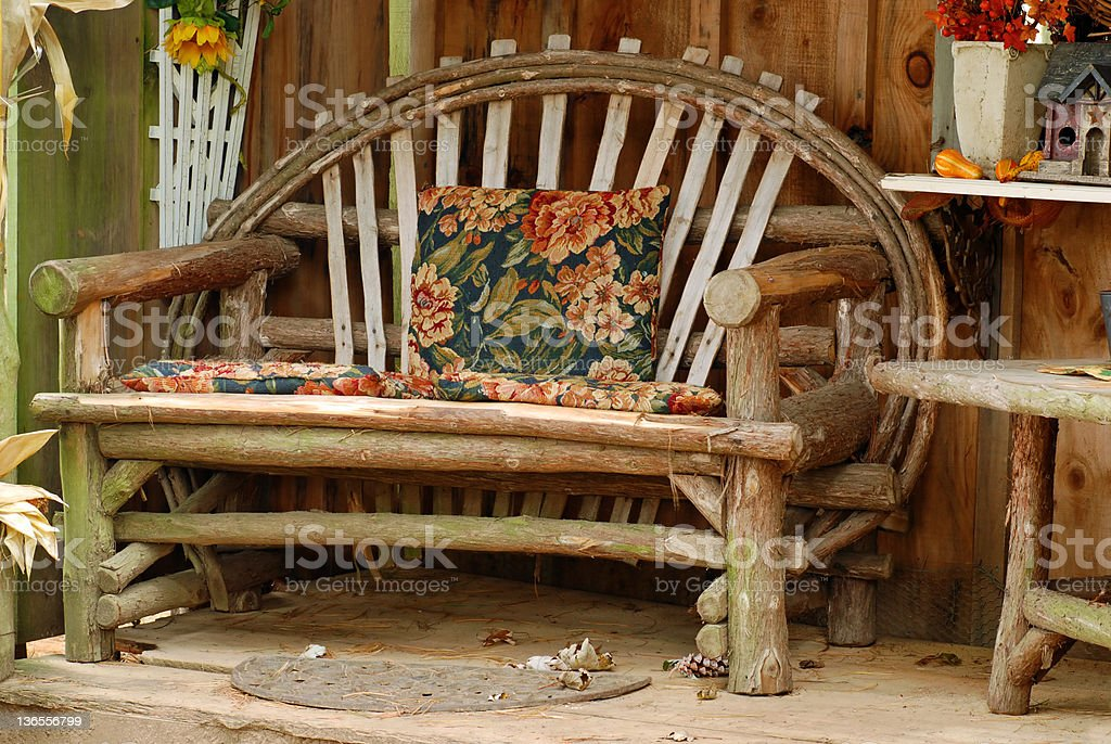 old bench made of tree branches royalty-free stock photo