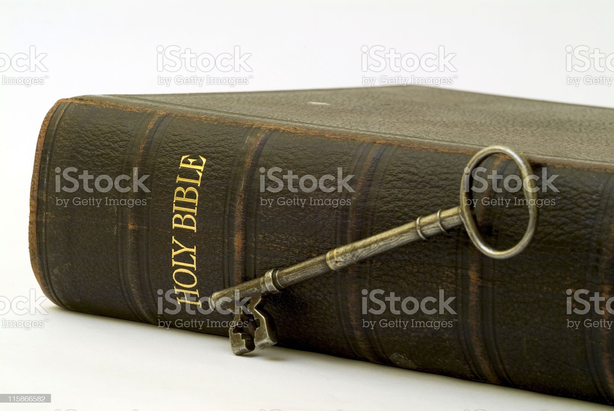 Old Bible on its side with church door key royalty-free stock photo
