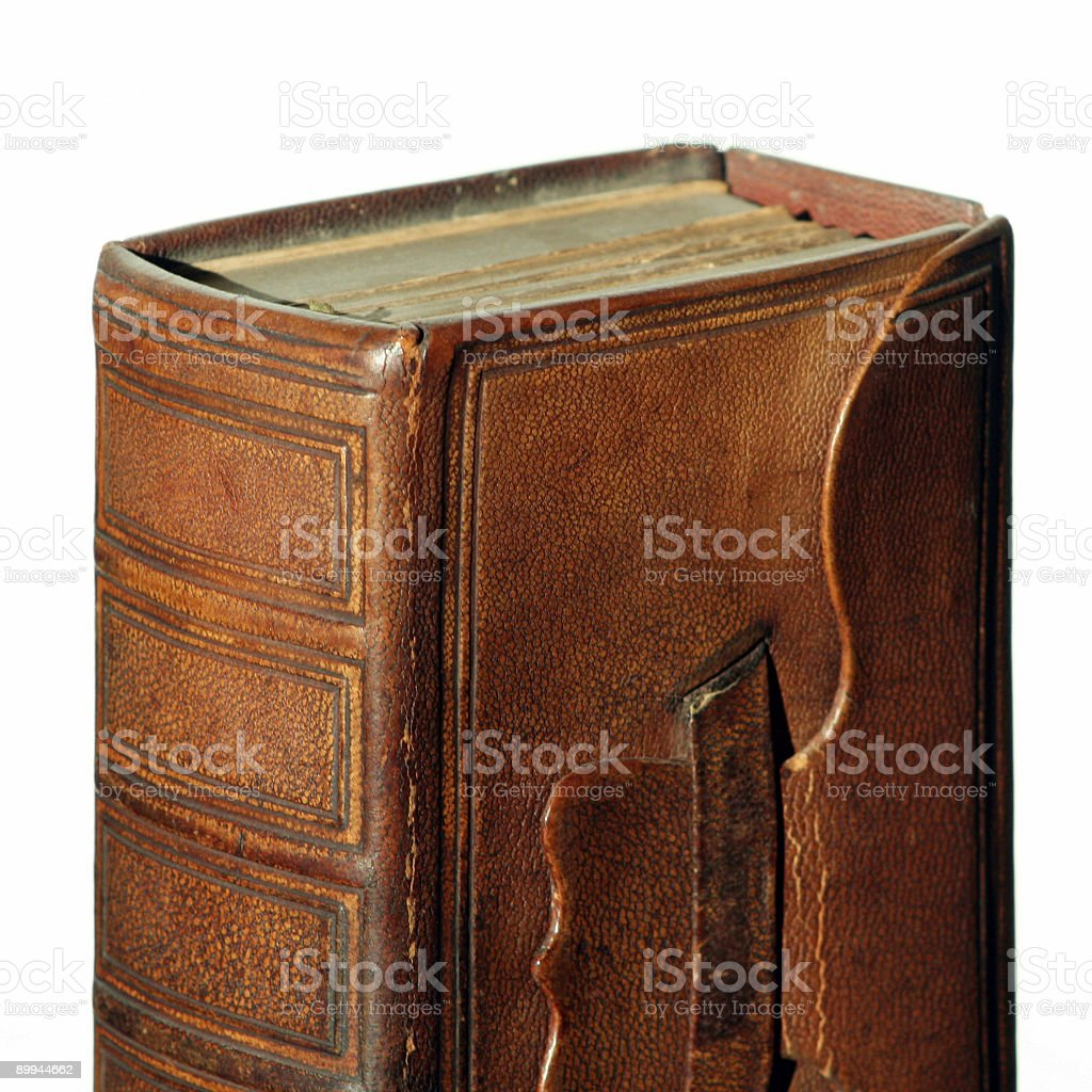 Old bible with leather cover on white royalty-free stock photo