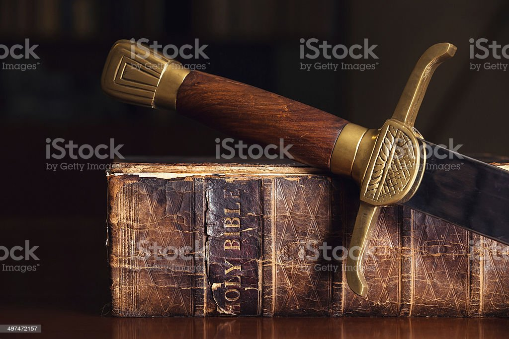 Old Bible With Sword stock photo