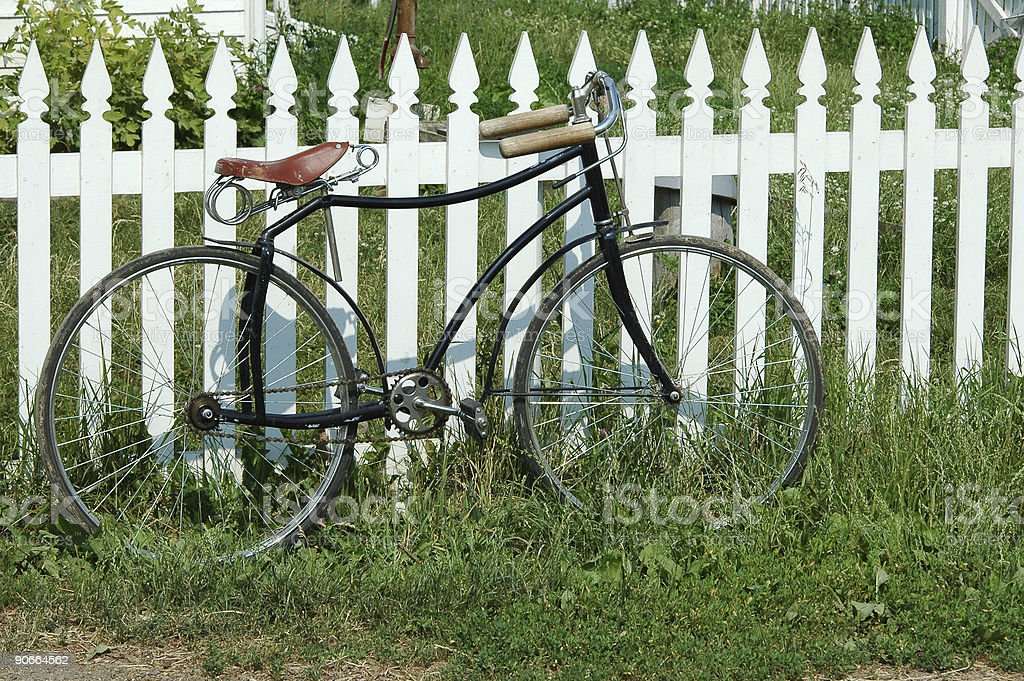 old bicycle against white picket fence royalty-free stock photo