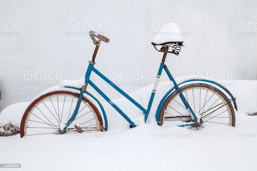 old bicycle covered with snow stock photo