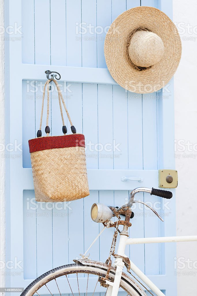 Old bicycle leaning against blue door. royalty-free stock photo