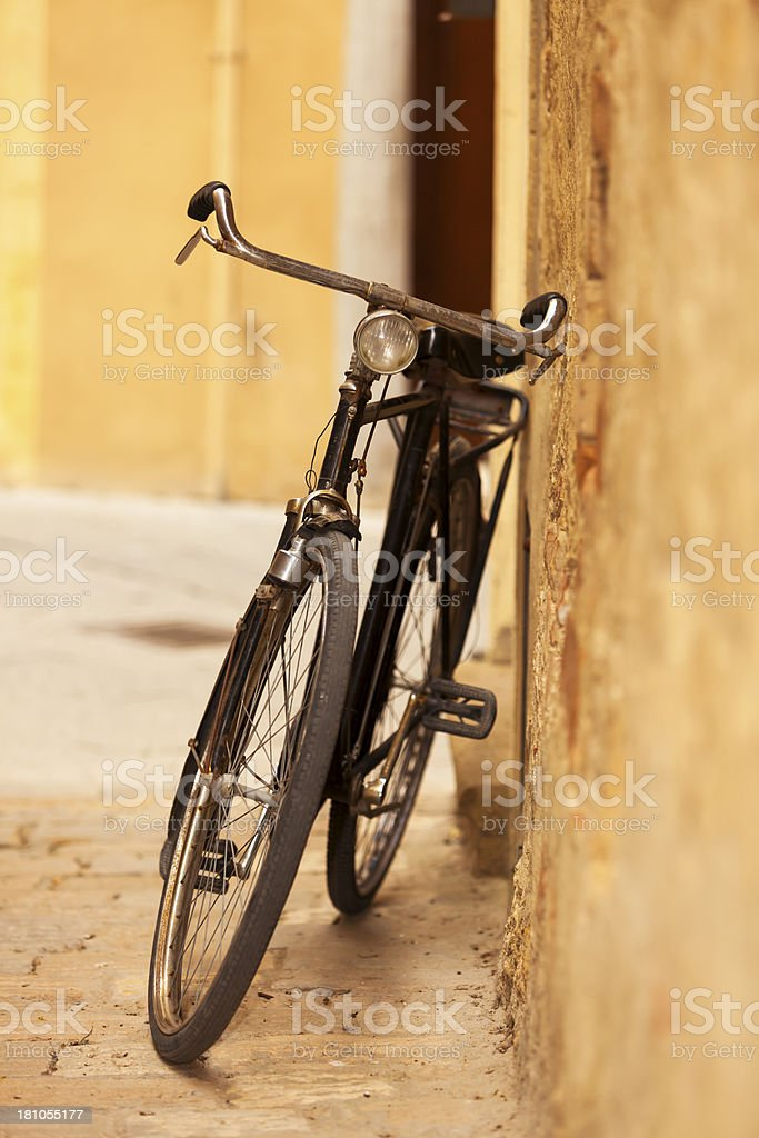 Old Bicycle Leaning Against Wall, Tuscany, Italy stock photo