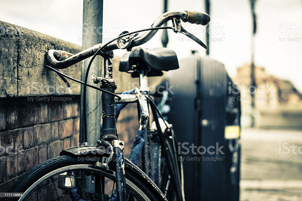 Old Bicycle Leaning in Italian Street royalty-free stock photo
