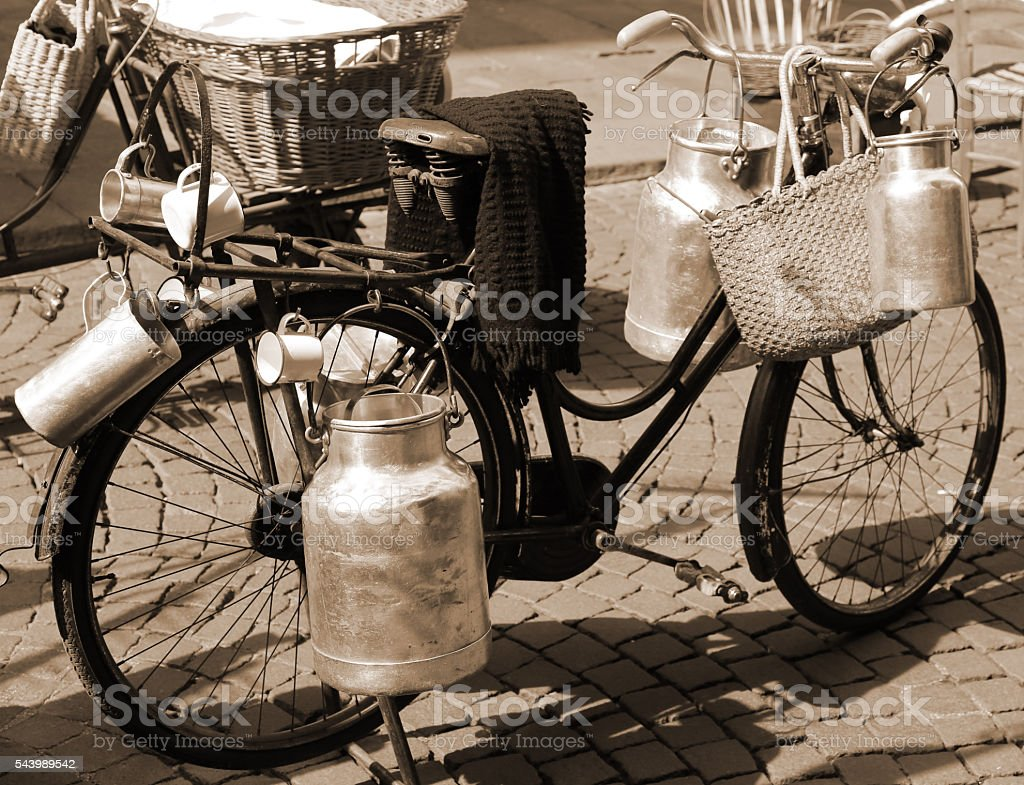 old bicycle of milkman for transporting milk cans stock photo