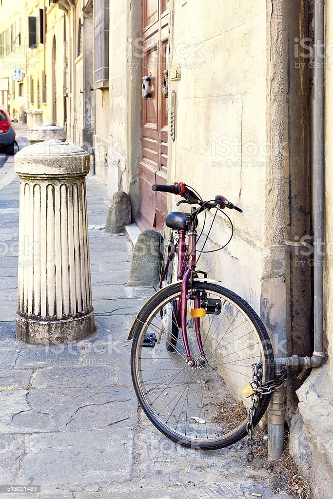 Old bicycle on the street stock photo
