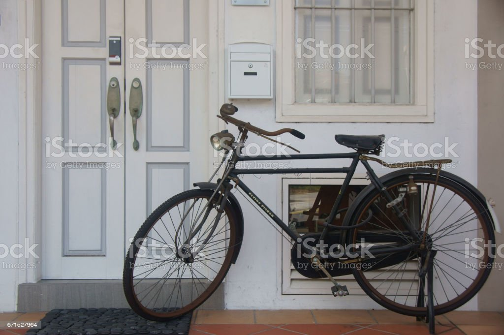 Old bicycle - Turn of century house stock photo