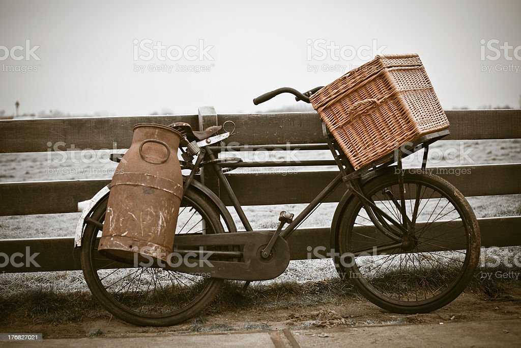 old bicycle with can and basket royalty-free stock photo