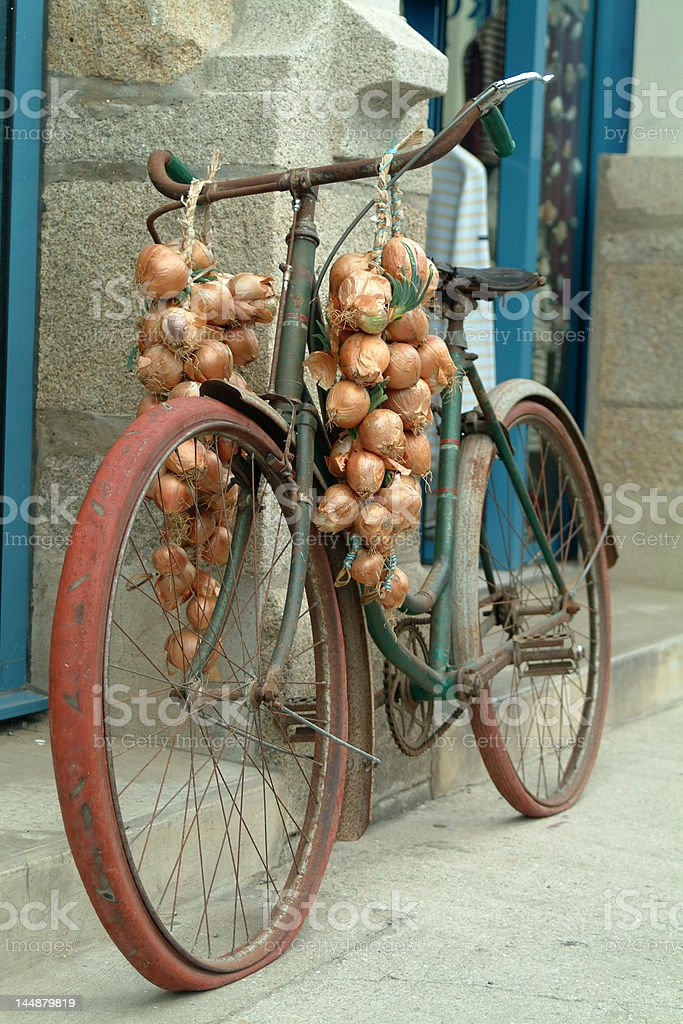 Old bicycle with onions royalty-free stock photo