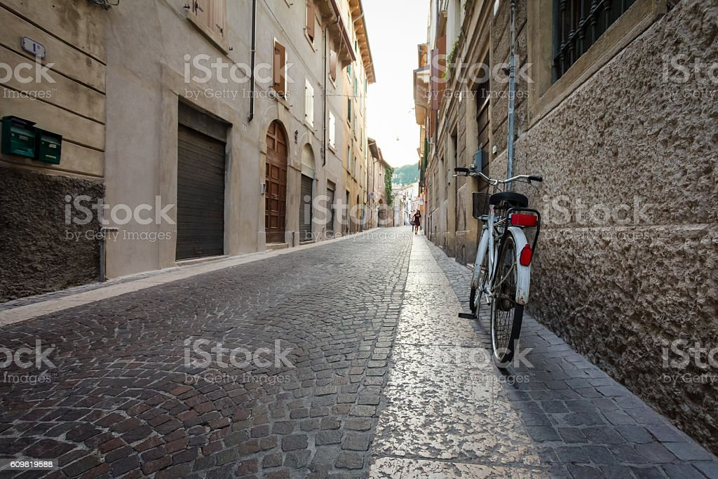 Old bicycle with wicker basket on the street. Florence, Italy stock photo