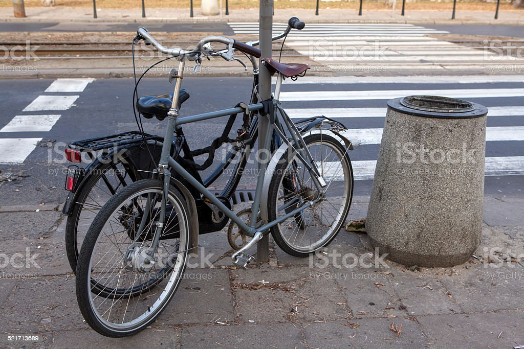 Old bicycles bound metal chain stock photo